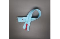Fermeture éclair bleue azur tirette rouge