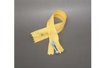 Fermeture éclair jaune tirette bleue